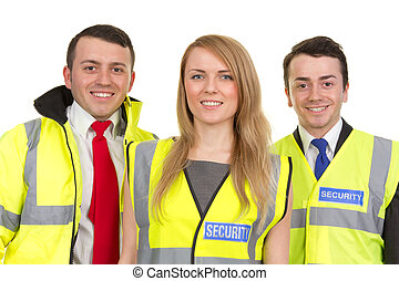 Three security guards - A trio of security guards wearing...