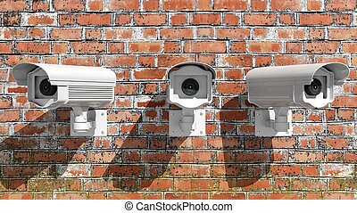 Three security surveillance cameras on brick wall