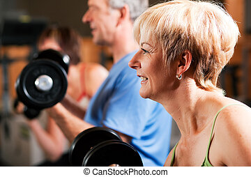 Three senior people in gym - Three senior people - two women...