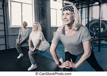 Three senior woman doing stretching together