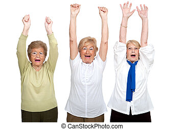 Three senior women raising hands.
