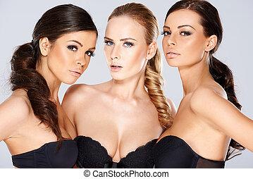 Three sensual beautiful young women