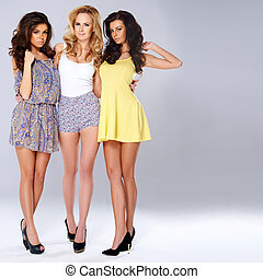 Three sexy chic young women in summer fashion