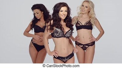 Three sexy ladies in chic black lingerie