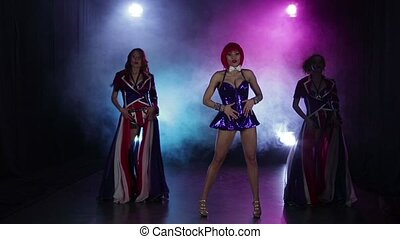 Three sexy PJ girls dancing together on scene in nightclub