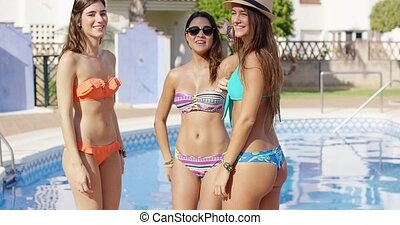 Three sexy trendy women in bikinis