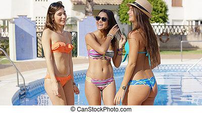 Three sexy trendy women in bikinis