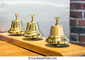 Three shiny golden vintage bells
