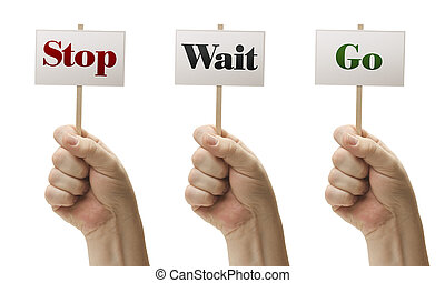 Three Signs In Fists Saying Stop, Wait and Go