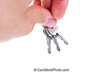 three silver keys in a hand