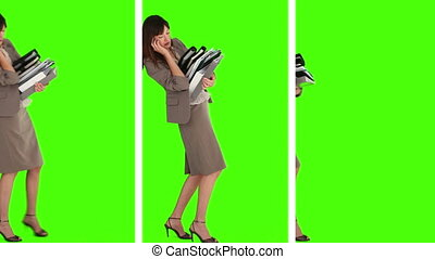 Three situations where we can see a businesswoman holding a lot of books against a green screen