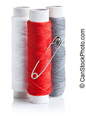 three skein of thread with pin
