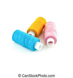three skeins of thread for embroidery yellow, pink and blue on a white isolated background