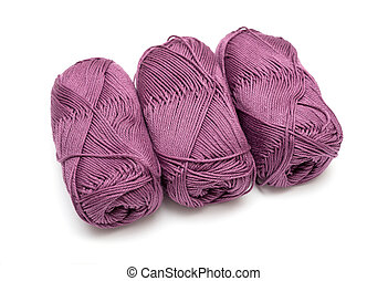 Three skeins of yarn isolated on white background