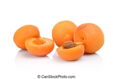Three sliced apricots isolated on white