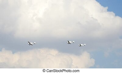 Three small airplanes for agricultural industry flying in...