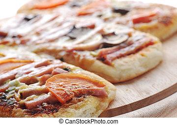 three small pizzas
