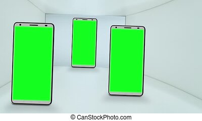 Three smartphones with green screens for the chroma key
