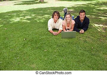 Three smiling students looking at camera