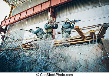 three soldiers freed the building from enemy