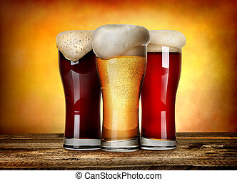 Three sorts of beer on a wooden table