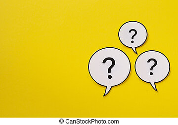 Three speech bubbles with question marks with copy space