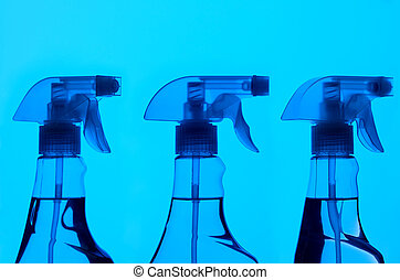 Three Spray Bottles With Blue Light