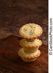 three stack of mincemeat pies