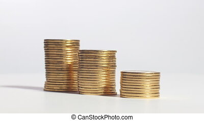 Three stacks of coins in shape of ladder