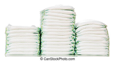 Three stacks of diapers isolated on white background