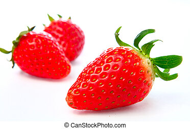 Three stawberries on the white background