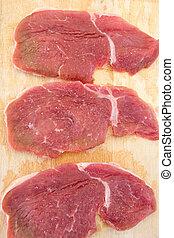 Three steaks raw salted pork