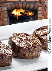 Three steaks roasted on the grill