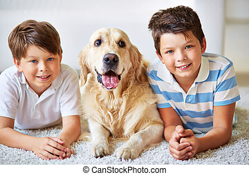 Three - Portrait of two little boys and a dog