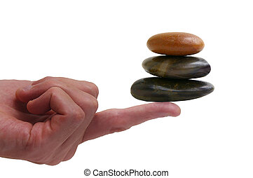 three stone balancing on a finger, over white