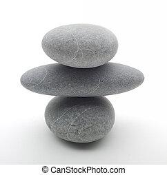 three stones in balance