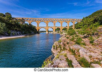 Three-storied aqueduct of Pont du Gard in Europe -...