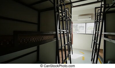 Three-story beds in a budget Asian hostel. - Three-story...