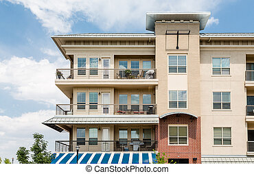 Three Story Condo Over Blue and White Awning - Modern brick ...