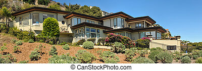 Three story house on a hillside with fence - Moder house on ...