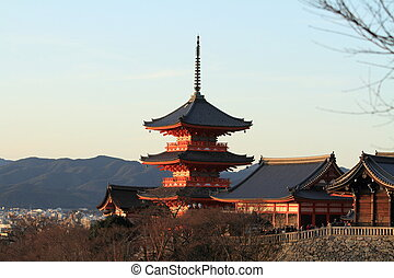 three-story pagoda of Kiyomizu dera in Kyoto, Japan (evening...