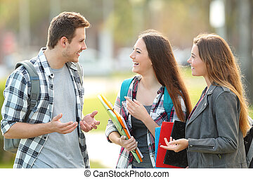Three students are talking in the street