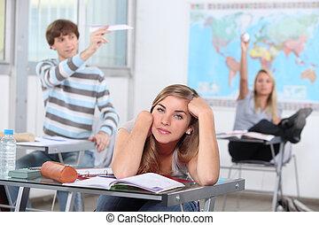 three students having break at school