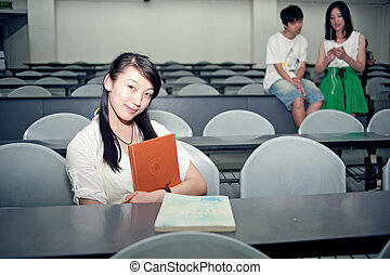 Three students in a classroom