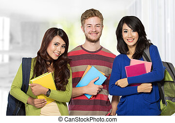 Three students smiling to camera