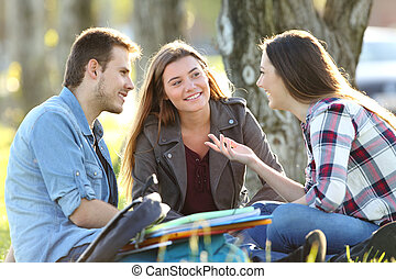 Three students talking after class