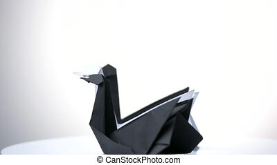 Three swans origami. Black and white paper swans on white...