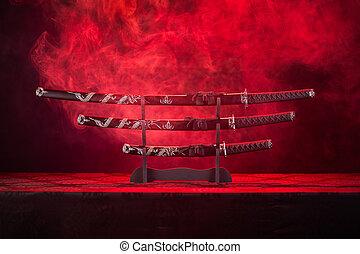 Three swords on stand, red smoke behind - Katana, wakizashi ...