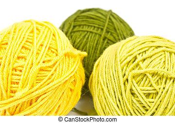 three tangle of wool yarn