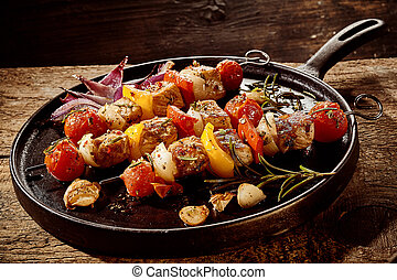 Three tasty barbecued meat and vegetable skewers